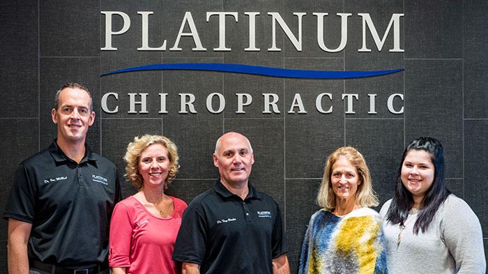 Chiropractor Eden Prairie MN Troy Boschee with Staff